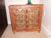 dark wood cabinet for sale with unusual brass detail on the front