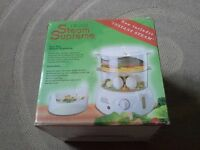 Brand new, Hinari 2 tier, supreme steamer, boxed, never used, with all instructions