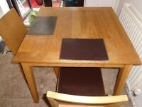 SQUARE OAK TABLE & 2 CHAIRS FOR SALE.