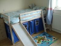 Childs bed with slide and storage/play area underneath
