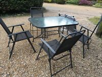 Garden table & six chairs ......hardly used