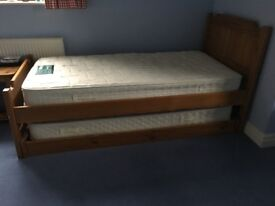 Solid wooden single bed that converts to double