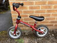 Small children's red balance bike