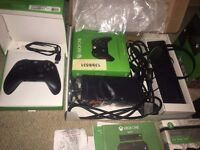 Xbox one boxed with new controllers and games