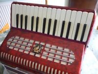 beautiful the parrot accordian,lovely red casing & straps,with original carrying case,as new v/nice.