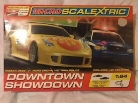 """Micro Scalextric Downtown Showdown"", Nissan 350Z V & Ford Crown Victoria Police Car. Used twice."