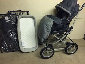 Mamas and Papas Pram with foot muff and rain cover, carry cot with cover.