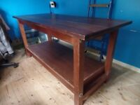 Wooden workbench, originally a carpenters but has been used as a pattern cutting table