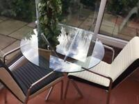 Glass table and two chairs