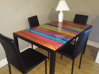 Stunning rainbow glass dining table with 4 chairs (as new)