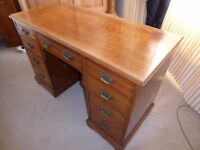 Desk, knee hole, cherry wood?, 8 locking drawers, glass top, 1.21m long, 53cms deep, 78cm wide