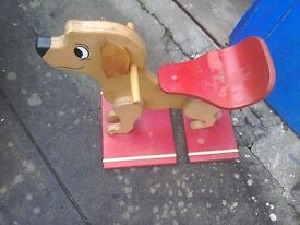 A wooden seat dog that a young child can move