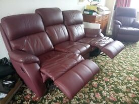 Leather 3-piece suite. Sofa has recliners.