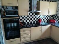 Complete Leekes beech effect kitchen with NEFF appliances