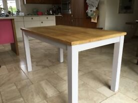 A pine rectangular table with painted legs