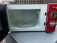 Red Microwave and kitchen accessories