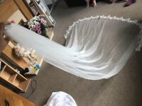 Long ivory cathedral veil