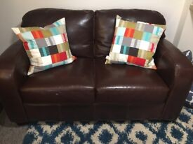 Brown leather two seater settee