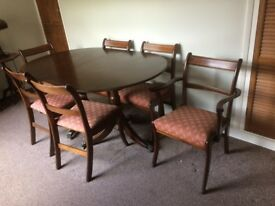 Dining table (160cm extendable to 215cm, 100 wide) and 6 chairs (including 2 carvers) dark oak