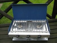 GAS CAMPINGAZ CAMPING CHEF COOKER, IT HAS 2 BURNERS AND A GRILL AND GRILL PAN, FOLDS FLAT FOR EASY