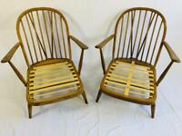 A pair of Ercol 203 armchairs
