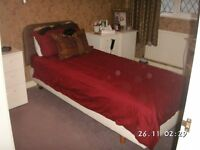 Single all adjusting bed with remote control keypad
