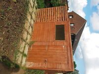 Garden shed with added log storage