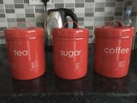 Red kitchen canisters.