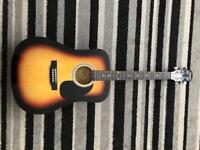 Acoustic guitar with capo, stand and electric tuner