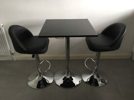 Two Black & Chrome Bar Stools and Table.