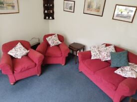 Red sofa and armchairs feather cushions. Covers removablr