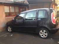 black skoda roomster 1.4 tdi