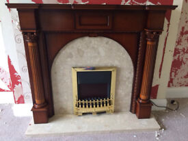 Wooden fireplace with marble hearth and back