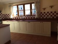 Used ex Shaston Buttermilk Ivory Kitchen and utility room units with Corian worktops in kitchen
