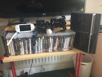 PlayStation3 with 40 games, 2 controllers, camera, earpiece, move controls