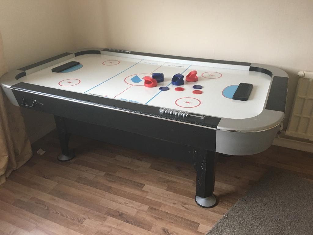 Air Hockey Table with pucks, delivery available.