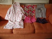 GIRLS DRESSING GOWN and TWO SETS OF PYJAMAS.