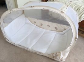 Very compact travel cot