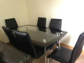Glass dining room table black, 6 x black leather chairs