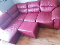 Red leather corner sofa chair and footstool