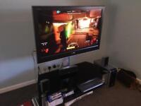 Sony TV, TV stand and 5.1 Samsung surround sound for sale