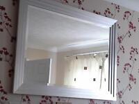 large silver framed bevilled mirror