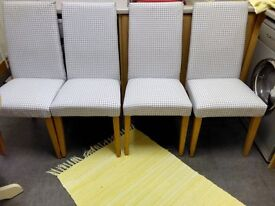 NEXT SET OF FOUR HIGH BACKED PADDED DINING CHAIRS, WITH SOLID OAK LEGS