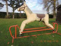 LARGE ROCKING HORSE Metal frame & pap'ier-mache horse.