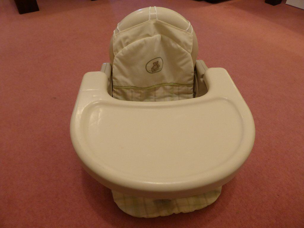 Brilliant travel highchair sits on a chair and
