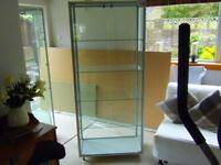 2 Glass display cabinets with 4 shelves and door locks