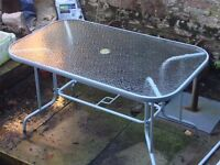 Glass topped outdoor table and six chairs