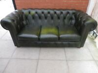 A Dark Green Leather Chesterfield Three Seater Sofa