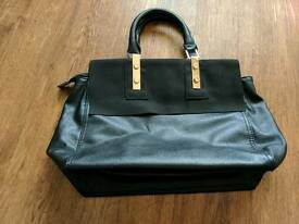 Ladies black & gold warehouse hand bag