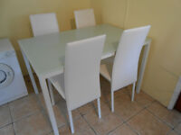 White dining table and four white chairs in white chrome